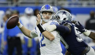 Detroit Lions quarterback Jeff Driskel (2) is pressured by Dallas Cowboys defensive end Demarcus Lawrence during the first half of an NFL football game, Sunday, Nov. 17, 2019, in Detroit. (AP Photo/Duane Burleson)