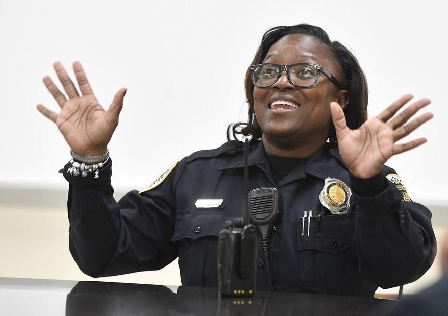 School resources Officer Angela Booker saw a need for a summer camp for girls with special needs. So she started one. With her own money. On her own time. Thursday, Nov. 7, 2019, in Nashville, Tenn. (Larry McCormack/The Tennessean via AP)