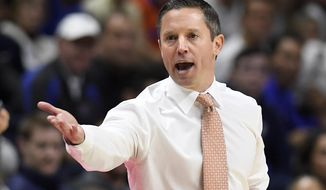 Florida head coach Mike White calls to an official during the first half of an NCAA college basketball game against Connecticut, Sunday, Nov. 17, 2019, in Storrs, Conn. (AP Photo/Jessica Hill)