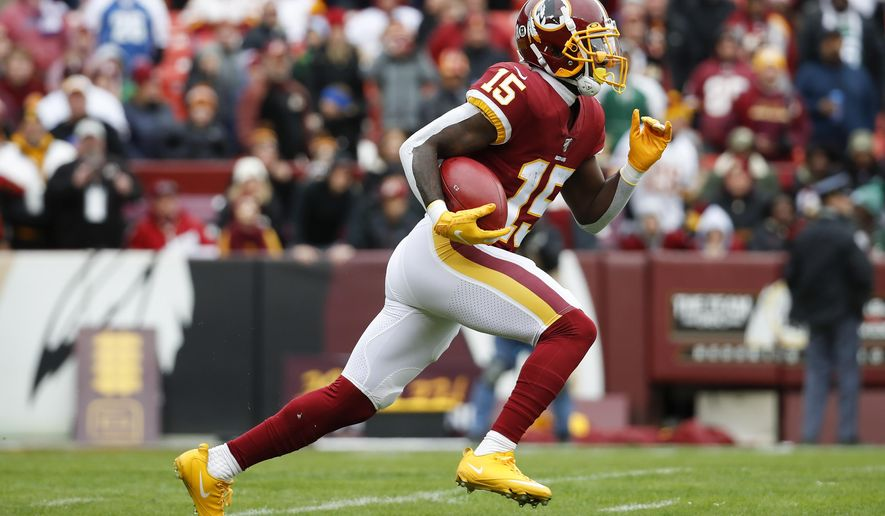 Washington Redskins wide receiver Steven Sims (15) runs with the ball during first half of an NFL football game against the New York Jets, Sunday, Nov. 17, 2019, in Landover, Md. (AP Photo/Alex Brandon)