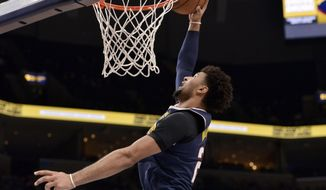 Denver Nuggets guard Jamal Murray dunks in the first half of an NBA basketball game against the Memphis Grizzlies, Sunday, Nov. 17, 2019, in Memphis, Tenn. (AP Photo/Brandon Dill)