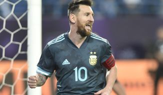 Argentina's Lionel Messi celebrates after scoring his side's opening goal during a friendly soccer match between Brazil and Argentina at King Fahd stadium in Riyadh, Saudi Arabia, Friday, Nov. 15, 2019. (AP Photo)