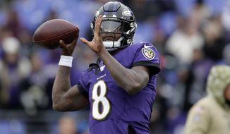 Baltimore Ravens quarterback Lamar Jackson works out prior to an NFL football game against the Houston Texans, Sunday, Nov. 17, 2019, in Baltimore. (AP Photo/Julio Cortez)