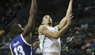Texas-Arlington's Jabari Narcis, pressures Oregon's Chris Duarte on a shot during the first half of an NCAA college basketball game in Eugene, Ore., Sunday, Nov. 17, 2019. (AP Photo/Chris Pietsch)