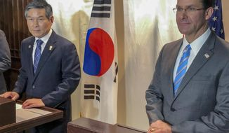 U.S. Defense Secretary Mark Esper, right and South Korea defense Minister Jeong Kyeong-doo, left attend a press conference in Bangkok, Thailand, Sunday, Nov. 17, 2019. Mark Esper and his South Korean counterpart announced Sunday that US and South Korea are postponing a joint military air exercise that North Korea has criticized as provocative. (AP Photo/Robert Burns)