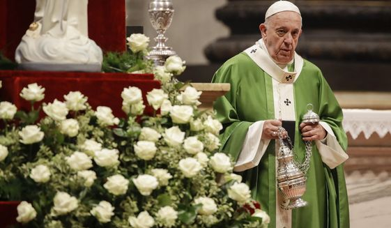Pope Francis arrives to celebrate a Mass in St. Peter Basilica at the Vatican, Sunday, Nov. 17, 2019. Pope Francis is offering several hundred poor people, homeless, migrants, unemployed a lunch on Sunday as he celebrates the World Day of the Poor with a concrete gesture of charity in the spirit of his namesake, St. Francis of Assisi. (AP Photo/Alessandra Tarantino)