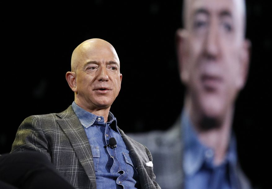 Amazon CEO Jeff Bezos speaks at the the Amazon re:MARS convention, Thursday, June 6, 2019, in Las Vegas. (AP Photo/John Locher)