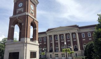 In this June 16, 2019, file photo, the Autherine Lucy Clock Tower at the Malone Hood Plaza stands in front of Foster Auditorium on the University of Alabama campus in Tuscaloosa, Ala. (AP Photo/Bill Sikes, File)