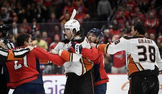 Washington Capitals right wing Garnet Hathaway (21) scuffles with Anaheim Ducks defenseman Erik Gudbranson, second from left, during the second period of an NHL hockey game, Monday, Nov. 18, 2019, in Washington. Also seen is Capitals center Chandler Stephenson, second from right, and Ducks center Derek Grant (38). (AP Photo/Nick Wass) ** FILE **