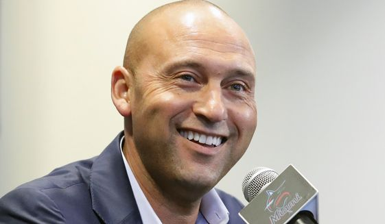 In this Sept. 20, 2019, file photo, Miami Marlins CEO Derek Jeter smiles as he speaks during a news conference in Miami. Derek Jeter is among 18 newcomers on the 2020 Hall of Fame ballot, announced Monday, Nov. 18, 2019, and is likely to be an overwhelming choice to join former New York Yankees teammate Mariano Rivera in Cooperstown after the reliever last year became the first unanimous pick by the Baseball Writers' Association of America. (AP Photo/Wilfredo Lee) ** FILE **