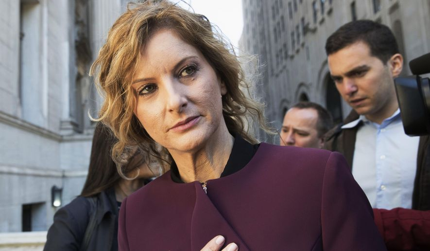 """In this Oct. 18, 2018, file photo, Summer Zervos leaves New York state appellate court in New York. President Donald Trump has lost his latest bid to delay the former """"Apprentice"""" contestant's defamation suit as he faces a Jan. 31, 2020, deadline to undergo sworn pretrial questioning. (AP Photo/Mary Altaffer, File)"""