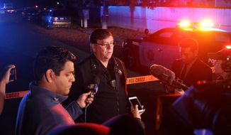 Fresno Police Lt. Bill Dooley speaks to reporters at the scene of a shooting at a backyard party Sunday, Nov. 17, 2019, in southeast Fresno, Calif. Multiple people were shot and at least four of them were killed Sunday at a party in Fresno when suspects sneaked into the backyard and fired into the crowd, police said. (Larry Valenzuela/The Fresno Bee via AP)