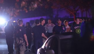 Police and emergency personnel are on the scene of a shooting at a backyard party, Sunday, Nov. 17, 2019, in southeast Fresno, Calif. Multiple people were shot and at least four of them were killed Sunday at a party in Fresno when suspects sneaked into the backyard and fired into the crowd, police said.  (Larry Valenzuela//The Fresno Bee via AP)