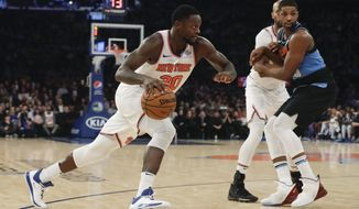 New York Knicks' Julius Randle (30) drives past Cleveland Cavaliers' Tristan Thompson, right, during the first half of an NBA basketball game Monday, Nov. 18, 2019, in New York. (AP Photo/Frank Franklin II)