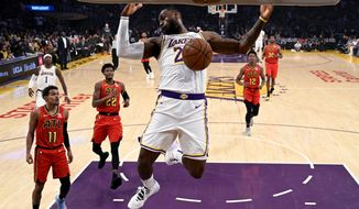 Los Angeles Lakers' LeBron James (23) dunks against Atlanta Hawks during the first half of an NBA basketball game, Sunday, Nov. 17, 2019, in Los Angeles. (AP Photo/Ringo H.W. Chiu)