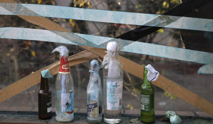 Molotov cocktails are left over at the Hong Kong Polytechnic University campus in Hong Kong on Tuesday, Nov. 19, 2019. Police tightened their siege of the university campus where hundreds of protesters remained trapped overnight Tuesday in the latest dramatic episode in months of protests against growing Chinese control over the semi-autonomous city. (AP Photo/Ng Han Guan)