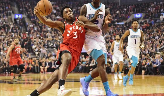 Toronto Raptors forward OG Anunoby (3) drives as Charlotte Hornets forward Marvin Williams (2) defends during first half NBA action in Toronto on Monday, Nov. 18, 2019. (Frank Gunn/The Canadian Press via AP)