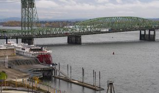 The Interstate 5 bridge is seen here from the Washington side on Monday, Nov. 18, 2019. The governors of Washington and Oregon are meeting to announce their joint plan to revive the Columbia River Crossing project. The project seeks to replace the aging Interstate 5 bridge over the Columbia River. (Nathan Howard/The Columbian via AP)