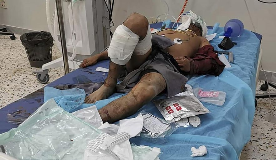 A man injured in an airstrike that hit a biscuit factory is treated in a hospital in the capital, Tripoli, Libya, Monday, Nov. 18, 2019. Tripoli has been the scene of fighting since April between the self-styled Libyan National Army and an array of militias loosely allied with the U.N.-supported but weak government which holds the capital. (Center for Field Medicine and Support via AP)