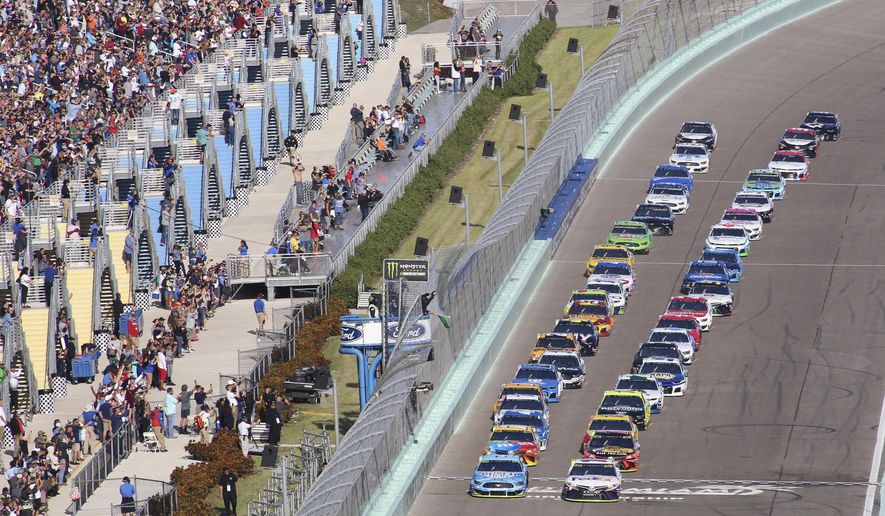 Denny Hamlin (11) leads the field to start a NASCAR Cup Series auto race on Sunday, Nov. 17, 2019, at Homestead-Miami Speedway in Homestead, Fla. (AP Photo/Jim Topper)