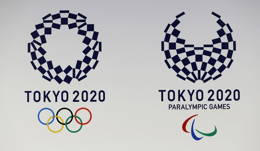 FILE - In this April 25, 2016, file photo, official logos of the 2020 Tokyo Olympics, left, and the 2020 Tokyo Paralympic Games are displayed by the Tokyo Organizing Committee, in Tokyo. Tokyo's Olympic marathons and race walks, which moved last month to the northern city of Sapporo to avoid the capital's summer heat, is likely to start and finish in the city's Odori Park according to officials Monday. (AP Photo/Shizuo Kambayashi, File)