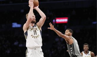Indiana Pacers forward Domantas Sabonis (11) shoots with Brooklyn Nets guard Garrett Temple (17) watching during the first half of an NBA basketball game, Monday, Nov. 18, 2019, in New York. (AP Photo/Kathy Willens)