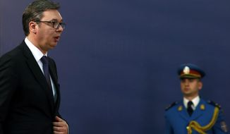 In this April 23, 2018, photo, Serbia's President Aleksandar Vucic arrives at a press conference in Belgrade, Serbia. The office of Serbia's president said Saturday, Nov. 16, 2019, he has been hospitalized with cardiovascular problems. (AP Photo/Darko Vojinovic)