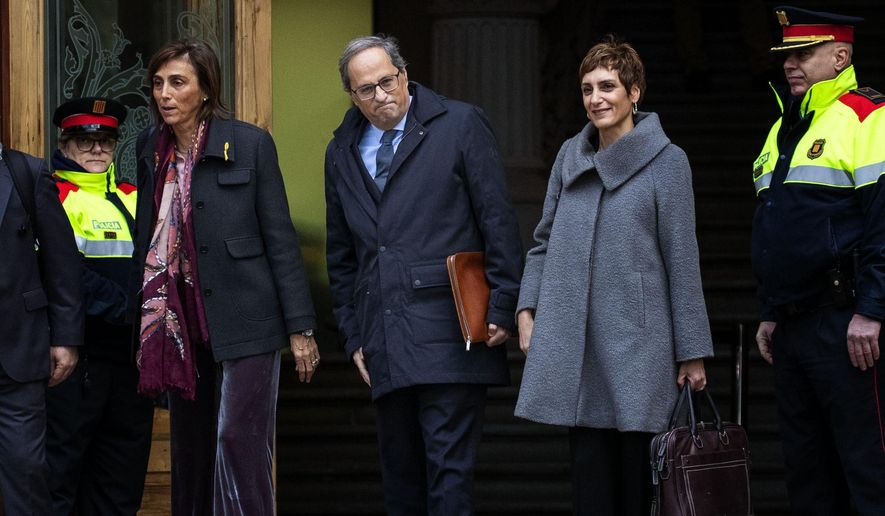 Catalan regional president Quim Torra, centre, arrives at the Catalonia's high court in Barcelona, Spain, Monday, Nov.18, 2019. Catalan President Quim Torra attends to a trial court in Barcelona on charges of disobedience over a political poster hung from the Catalan Government building during the general election campaign in March. (AP Photo/Emilio Morenatti)