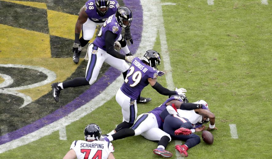 Houston Texans quarterback Deshaun Watson, right, fumbles the ball while being sacked by Baltimore Ravens outside linebacker Matt Judon during the first half of an NFL football game, Sunday, Nov. 17, 2019, in Baltimore. (AP Photo/Julio Cortez) ** FILE **