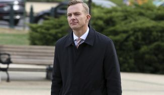 David Holmes, a career diplomat and the political counselor at the U.S. Embassy in Kyiv, Ukraine, arrives on Capitol Hill, Friday, Nov. 15, 2019, in Washington, to testify before congressional lawmakers as part of the House impeachment inquiry into President Donald Trump. (AP Photo/Jose Luis Magana)