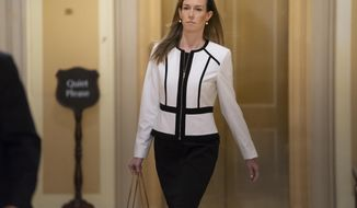 FILE - In this Nov. 7, 2019, file photo, Jennifer Williams, a special adviser to Vice President Mike Pence for Europe and Russia, arrives for a closed-door interview in the impeachment inquiry on President Donald Trump's efforts to press Ukraine to investigate his political rivals at the Capitol in Washington. A public appearance by an aide to Mike Pence before the House Intelligence Committee this week is drawing renewed attention to the vice president and what he knew about the events that sparked the House impeaching investigation.Williams is a career foreign service officer detailed to Pence's office from the State Department. She compiled briefing materials for him on Ukraine and was listened in on Trump's July 25 call with Zelenskiy. (AP Photo/J. Scott Applewhite, File)