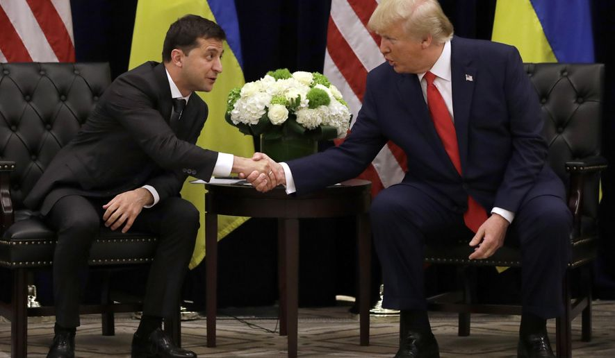 FILE - In this Sept. 25, 2019, file photo, President Donald Trump meets with Ukrainian President Volodymyr Zelenskiy at the InterContinental Barclay New York hotel during the United Nations General Assembly in New York.  (AP Photo/Evan Vucci, File)