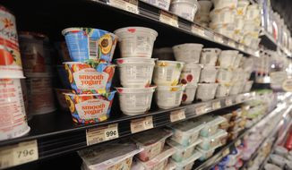 FILE - This July 11, 2018, file photo shows yogurt on display at a grocery store in River Ridge, La. Despite shelves full of new varieties, from Icelandic to Australian to coconut-based, U.S. yogurt sales are in a multiyear slump. Yogurt companies are confident that more new products can boost sales. But some analysts are skeptical, saying larger trends - like growing sales of breakfast protein bars - will be hard to turn around.  (AP Photo/Gerald Herbert, File-