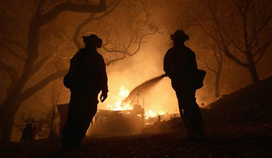 PARADISE, CALIFORNIA - NOVEMBER 09:  West Sacramento firefighters battle the Camp Fire on Honey Run Road in Paradise, Calif., on Friday, Nov. 9, 2018. (Ray Chavez/Digital First Media/The Mercury News via Getty Images)