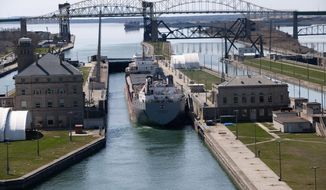 A ship navigates the Soo Locks between Lake Superior and Lake Huron on the St. Mary's River on United States (Michigan) and Canadian border. Image courtesy of the U.S. Army Corps of Engineers - Detroit District.
