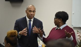 Former Massachusetts Gov. Deval Patrick, left, speaks with a business owner during a campaign stop, Tuesday, Nov. 19, 2019, in Columbia, S.C. (AP Photo/Meg Kinnard) ** FILE **
