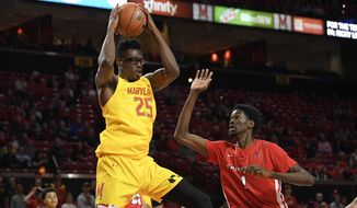 Maryland forward Jalen Smith (25) handles the ball next to Fairfield forward Chris Maidoh (1) during the second half of an NCAA college basketball game, Tuesday, Nov. 19, 2019, in College Park, Md. Maryland won 74-55. (AP Photo/Nick Wass) ** FILE **