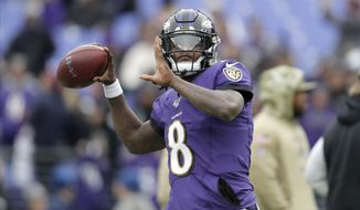 Baltimore Ravens quarterback Lamar Jackson works out prior to an NFL football game against the Houston Texans, Sunday, Nov. 17, 2019, in Baltimore. (AP Photo/Julio Cortez) ** FILE **