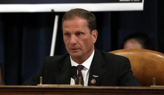 Rep. Chris Stewart, R-Utah, questions Jennifer Williams, an aide to Vice President Mike Pence, and National Security Council aide Lt. Col. Alexander Vindman, as they testify before the House Intelligence Committee on Capitol Hill in Washington, Tuesday, Nov. 19, 2019, during a public impeachment hearing of President Donald Trump's efforts to tie U.S. aid for Ukraine to investigations of his political opponents. (AP Photo/Jacquelyn Martin, Pool)