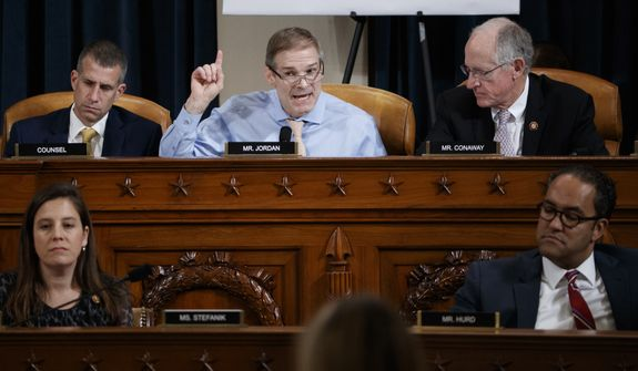 Rep. Jim Jordan, R-Ohio, top center, speaking as he is seated with top left, Steve Castro, the Republican staff attorney, top right, Rep. Mike Conaway, right, R-Texas, bottom left, Rep. Elise Stefanik, R-N.Y., and bottom right, Rep. Will Hurd, R-Texas, during testimony by Jennifer Williams, an aide to Vice President Mike Pence, and National Security Council aide Lt. Col. Alexander Vindman, before the House Intelligence Committee on Capitol Hill in Washington, Tuesday, Nov. 19, 2019, during a public impeachment hearing of President Donald Trump's efforts to tie U.S. aid for Ukraine to investigations of his political opponents. (Shawn Thew/Pool Photo via AP)
