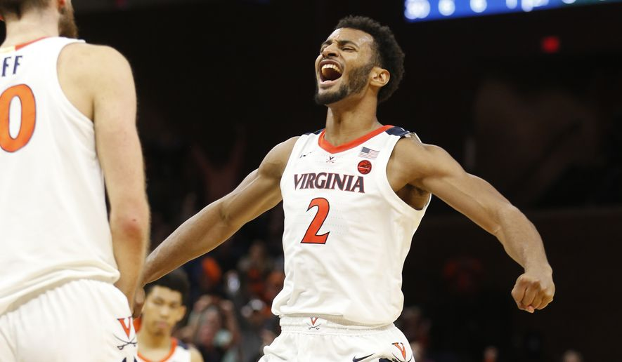 Virginia guard Braxton Key (2) celebrates a play during the second half of the team's NCAA college basketball game against Vermont on Tuesday, Nov. 19, 2019, in Charlottesville, Va. Virginia won 61-55. (AP Photo/Steve Helber)