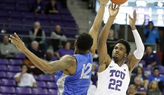 TCU forward RJ Nembhard (22) shoots over Air Force forward Lavelle Scottie (12) in the second half of an NCAA college basketball game in Fort Worth, Texas, Monday, Nov. 18, 2019. (Bob Booth/Star-Telegram via AP)