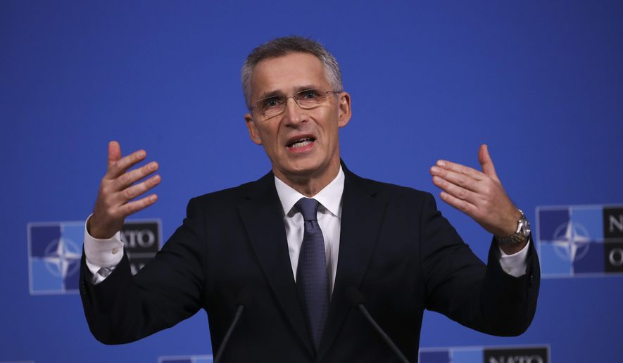 NATO Secretary General Jens Stoltenberg gestures as he answers a question during a news conference at NATO headquarters in Brussels, Tuesday, Nov. 19, 2019. The presser is ahead of a meeting of NATO Foreign Ministers to focus on defense spending, terrorism, and continued tense ties with Russia. (AP Photo/Francisco Seco)