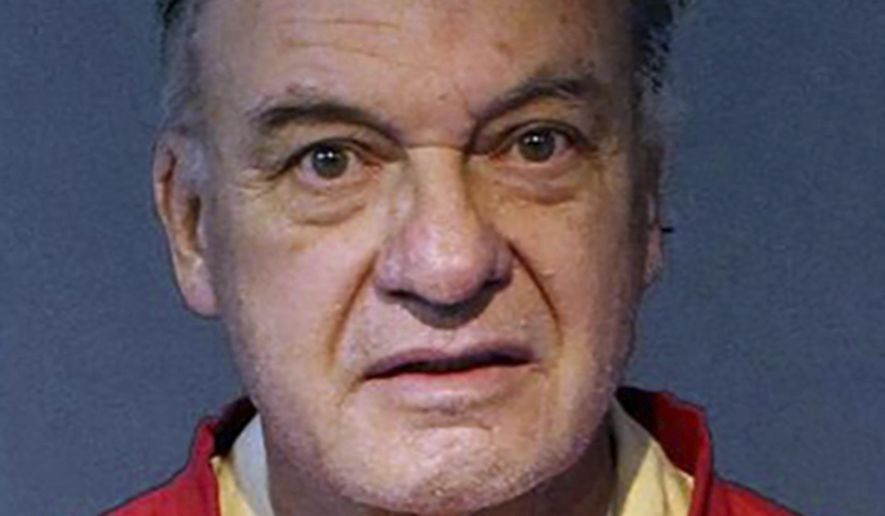 This undated photo released by the Washoe County Sheriff's Office shows Charles Gary Sullivan, 73, of Flagstaff, Ariz., following his booking on Friday, Nov. 15, 2019, into the Washoe County Jail in Reno. The auto dealer from Arizona is expected to plead not guilty in Reno in the cold-case killing of a California woman more than 40 years ago. Defense attorney David Houston said Monday, Nov. 18, he intends on Tuesday to challenge DNA evidence that prosecutors say leads to Sullivan. (Washoe County Sheriff's Office via AP)