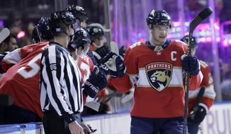 Florida Panthers center Aleksander Barkov is congratulated after scoring a goal during the second period of an NHL hockey game against the Philadelphia Flyers, Tuesday, Nov. 19, 2019, in Sunrise, Fla. (AP Photo/Lynne Sladky)
