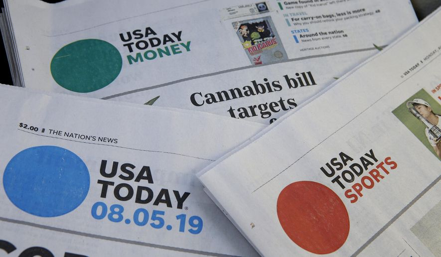 In this Aug. 5, 2019, file photo, sections of a USA Today newspaper rest together in Norwood, Mass. GateHouse Media has closed on its takeover of Gannett, bringing about 260 daily papers together to become the country's largest newspaper company by far. (AP Photo/Steven Senne, File)