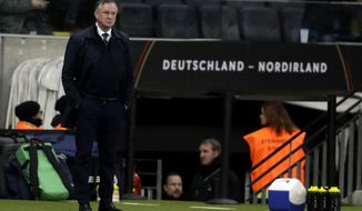 Northern Ireland's coach Michael O'Neill is seen during the Group C soccer qualifying match between Germany and Northern Ireland at the Commerzbank Arena in Frankfurt, Germany, Tuesday, Nov. 19, 2019. (AP Photo/Michael Probst)