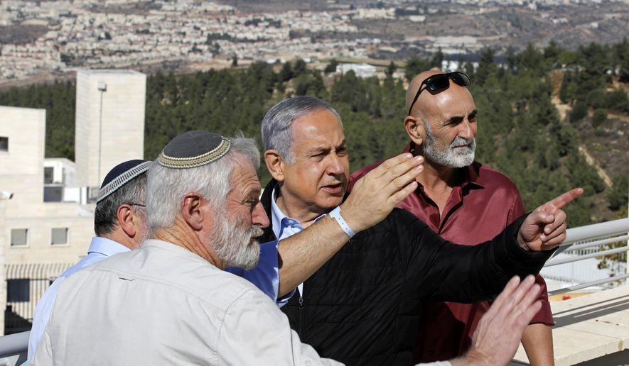 Israeli Prime Minister Benjamin Netanyahu, center, meets with heads of Israeli settlement authorities at the Alon Shvut settlement, in the Gush Etzion block, in the occupied the West Bank, Tuesday, Nov. 19, 2019. (Menahem Kahana/Pool via AP)