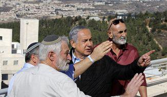 Israeli Prime Minister Benjamin Netanyahu, center, meets with heads of Israeli settlement authorities at the Alon Shvut settlement, in the Gush Etzion block, in the occupied the West Bank, Tuesday, Nov. 19, 2019. (Menahem Kahana/Pool via AP)