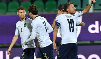 Italy's Ciro Immobile, right, celebrates with teammates after scoring his side's first goal during a group J qualifying soccer match between Italy and Armenia at the Renzo Barbera stadium, in Palermo, Italy, Monday, Nov. 18, 2019. (ANSA via AP)